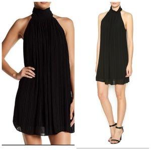 NWT Naked Zebra black sleeveless pleated dress
